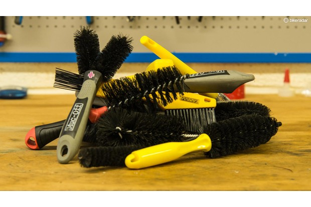 Soft-bristled brushes are useful for removing softened mud