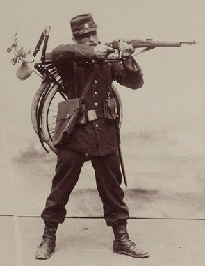 A pre-war photo of a French soldier with a Gladiator folding bicycle, which was developed in the late 1890s and saw limited use during the war