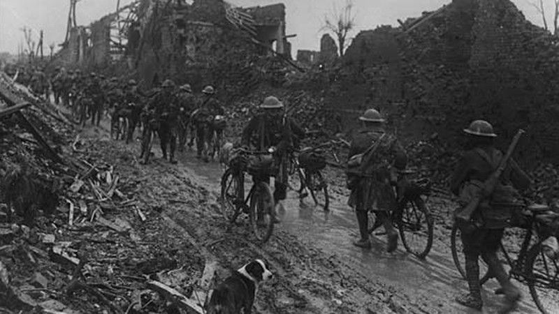 British soldiers manage to get through the mud and head to the front lines with their bicycles during the 1916 Somme campaign