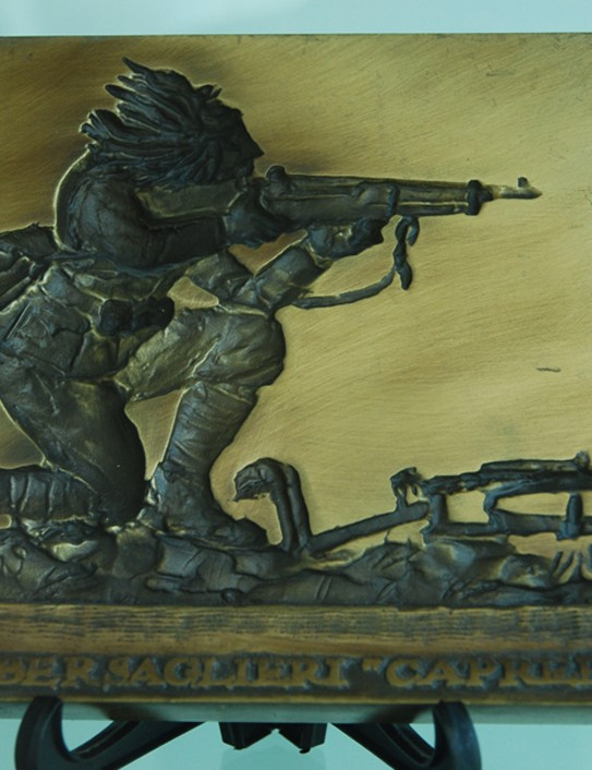 A plaque at the Italian Cyclist Museum & Hall of Fame depicting the efforts by the Italian Bersaglieri troops during the Great War