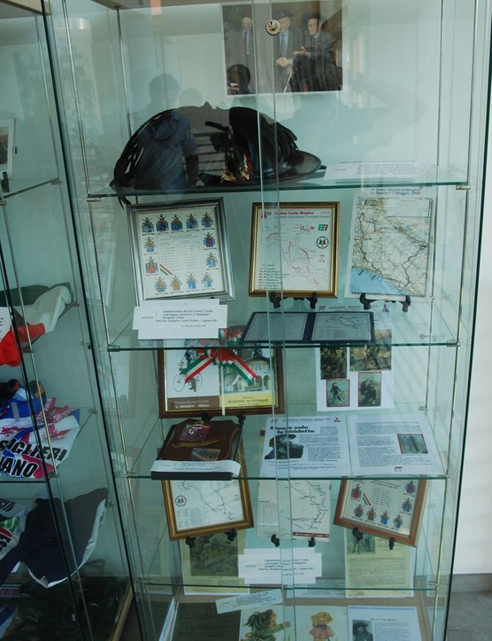 A display of Bersaglieri artifacts at the Italian Cyclist Museum & Hall of Fame