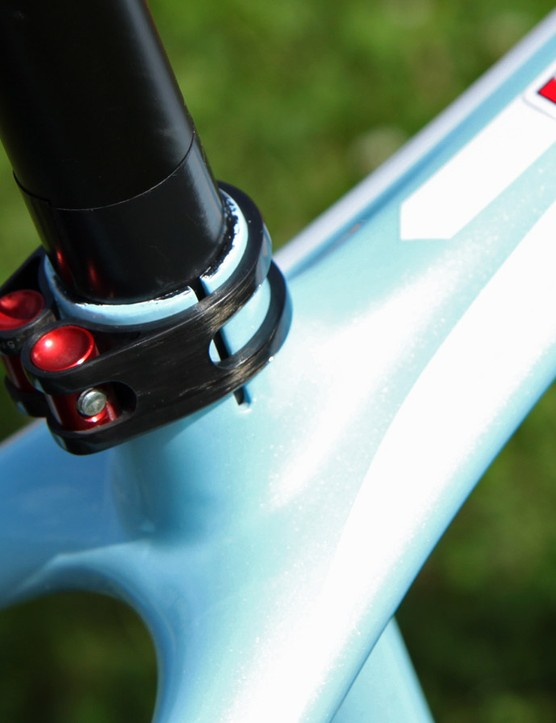 This trick carbon fiber seatpost clamp isn't some aftermarket bit - it's stock from Trek