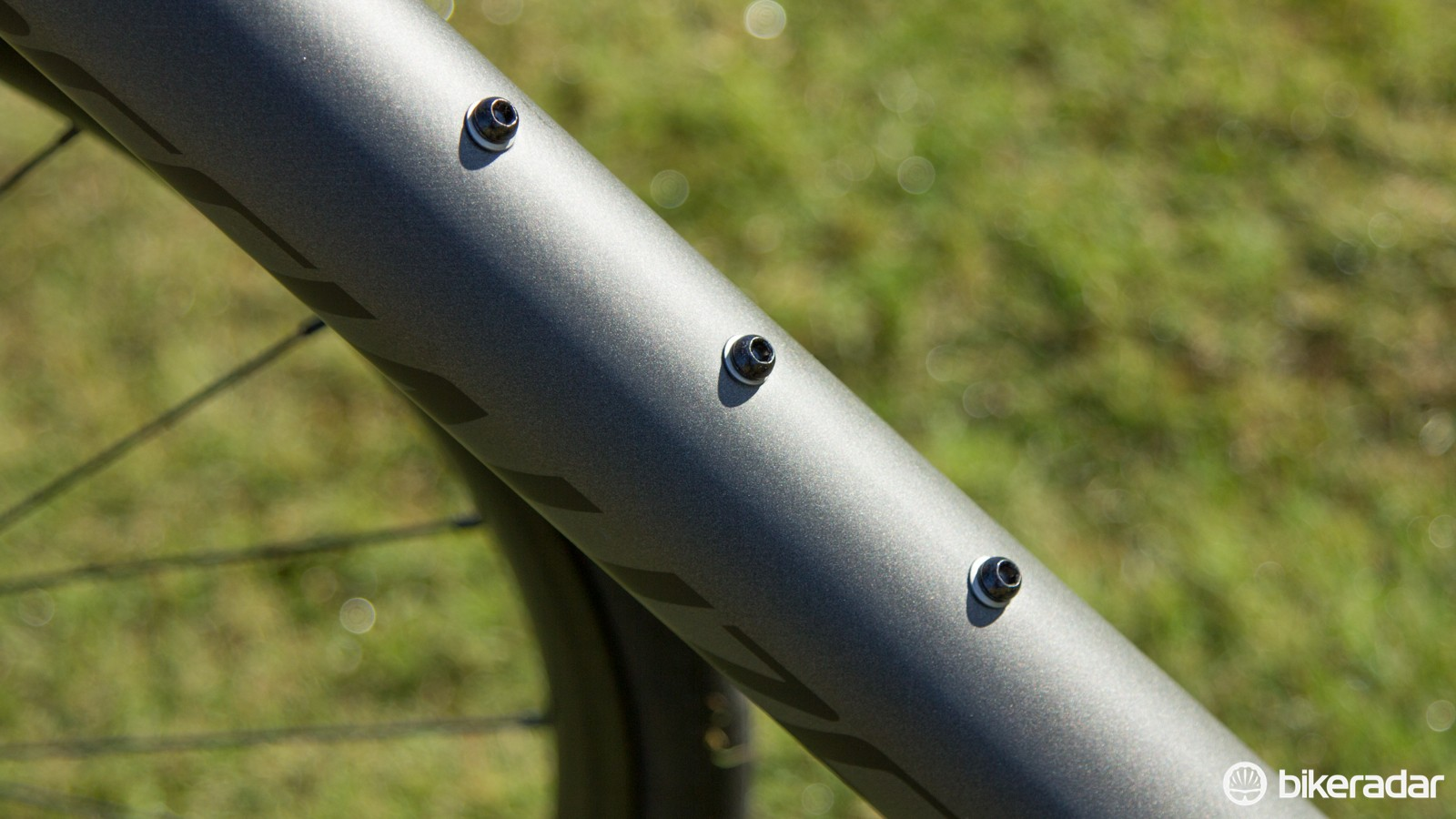 Three bidon cage holes in the Diverge Carbon models, the third is for a SWAT storage box