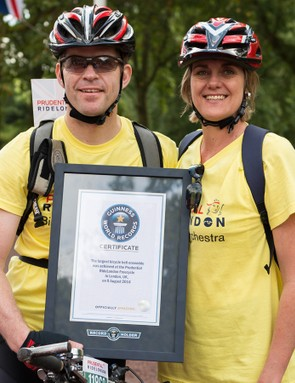 Members of the Bike Bell Orchestra pose with the Guinness World Record certificate