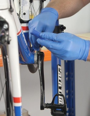 Start by loosening the bolts on the non-driveside crankarm