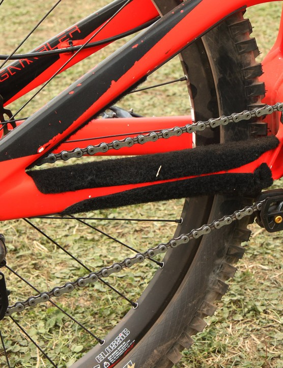 Downhill team mechanics are big fans of stick-on Velcro strips to quiet down chain slap