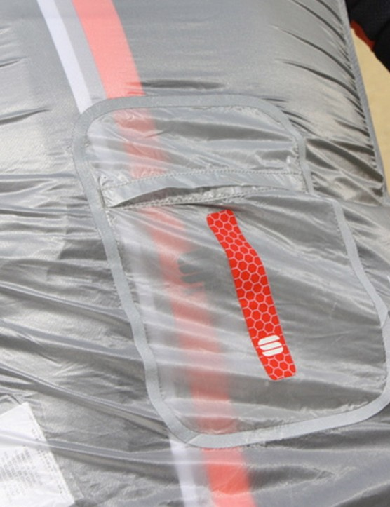 The vest packs down into its own pocket, which is bonded with reflective tape. Mesh side panels add breathability and a little stretch