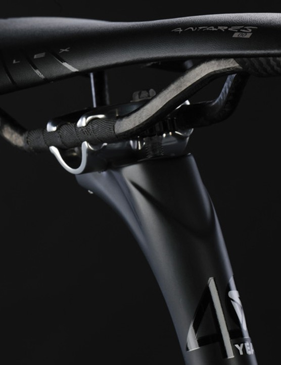 Fizik's Antares 00 saddle with braided carbon rails sits above Koga's UD carbon seat post