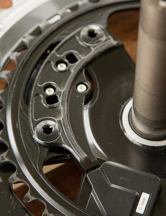 The driveside sensor is both epoxied and bolted into place via two of the crankset's chainring bolts
