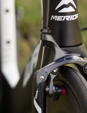 Direct mount brakes on the front aren't tucked behind or hidden, but should provide confident stopping power