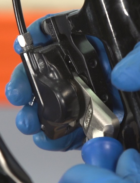 Start by pushing the pads into the caliper with a pad pusher tool or large flathead screwdriver