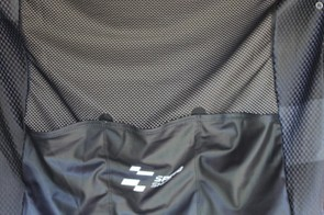 The front and back main panels are a thin, wicking mesh