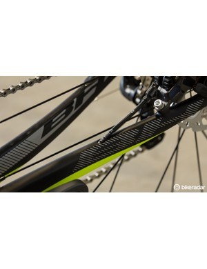 The rear brake is cleanly routed through the frame and pops out along the chainstay