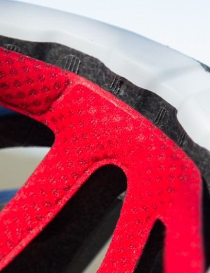 Taking the polycarbonate cover around the base of the helmet helps with durability