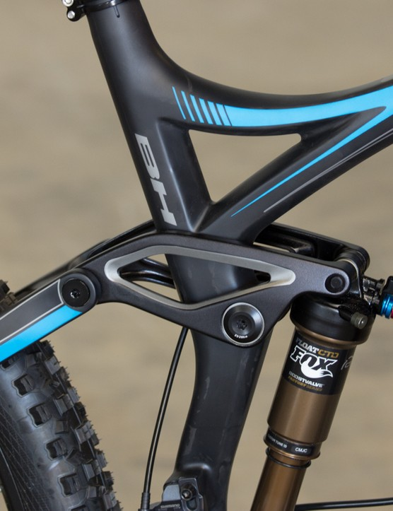 The Lynx 6 Carbon's rocker arms are machined alloy, where the rest of the frame is carbon. Note the new shock position that no longer pierces the seat tube