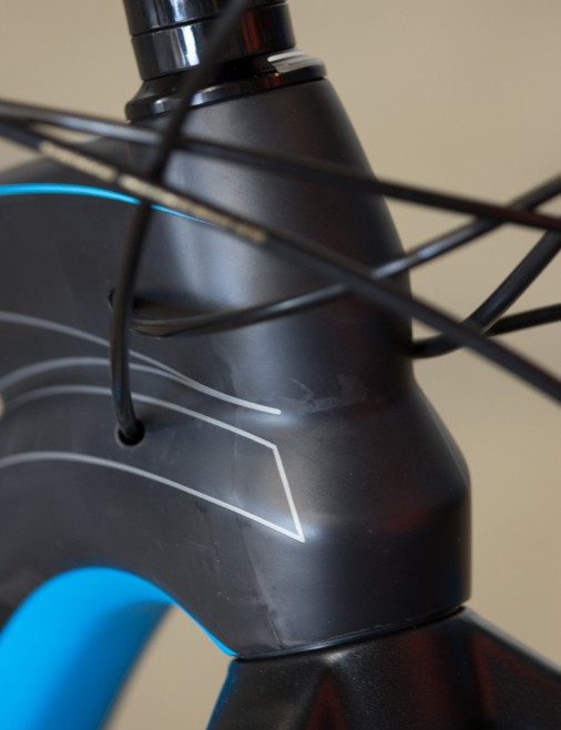 A shapely carbon tapered head tube has plenty of material behind it