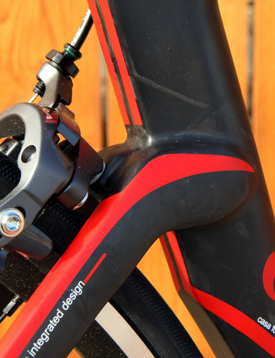 The wide seat stay spacing presumably helps direct air around the conventional rear brake caliper