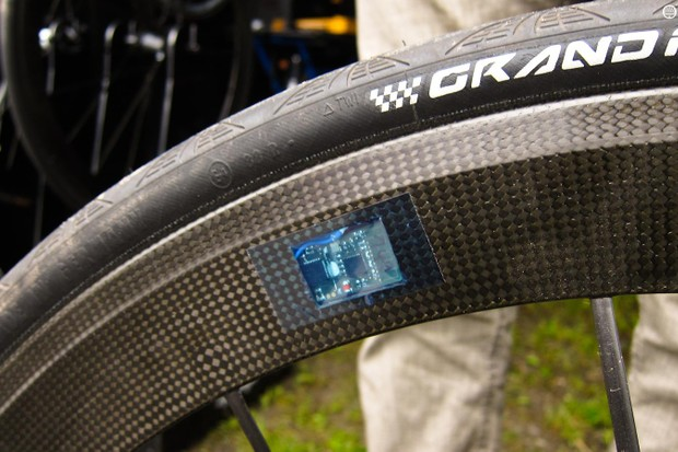 The sensor is a small chip encased within the rim