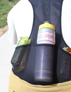 Besides the stretchy mesh, an elastic band at the top of the pockets should secure the goods while riding