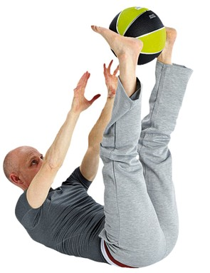Progress to holding a ball or medicine ball between your feet or hands
