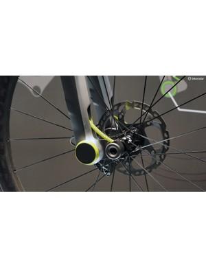 The simple pivoting front suspension design uses adjustable carbon fibre leaf springs and 'smart' magnetorheological rotary dampers