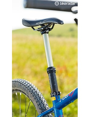A machined chainstay yoke facilitates tons of clearance and stealth dropper post routing