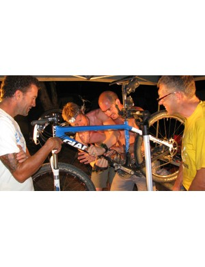 Mechanics Garrett Sherman and Micha Salden doing a carbon repair after a stick penetrated a frame