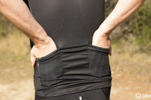 There's three basic rear pockets at the back. While things won't bounce out, the pockets are tight and on the small side