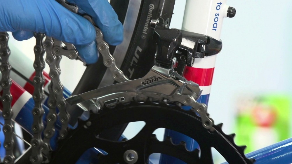 Run your chain through the mech and around the outer chainring