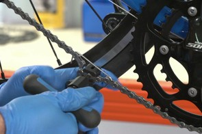 Reconnect Shimano chains using a chain tool and Shimano joining pin