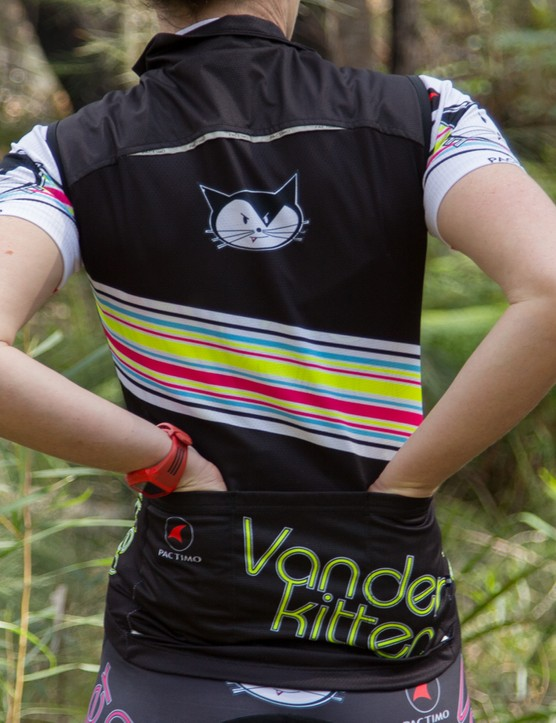 The vest features three rear pockets and some reflective strips for safety at night