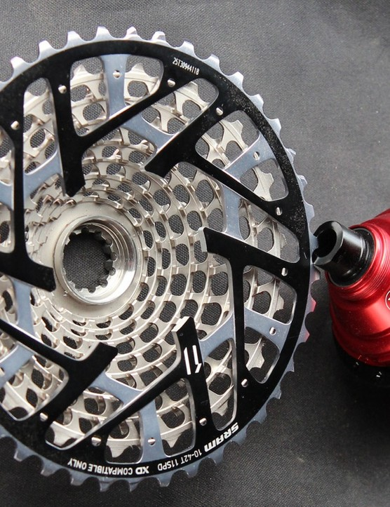 By trimming out parts of the back of a SRAM XX1 cassette, Kappius could build a much larger pawl ring, which the company says makes for a stronger, faster-engaging hub