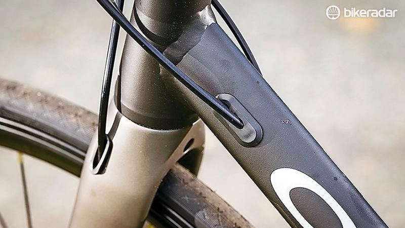 The front brake cable is very neatly routed through the left fork leg