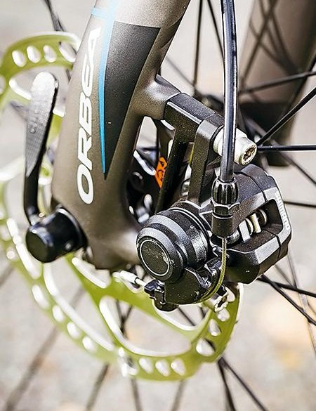 They don't have the same feel as hydraulics, but Shimano's budget cable discs are still an excellent option