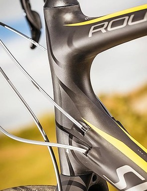 Smooth lines and internal cable routing are frame highlights