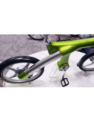 The unique frame features a massive, single-sided arm to support the rear wheel