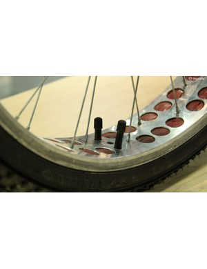 Wider rims were already available, though inner tubes were not. The solution was to use two, or even three, tubes per tire