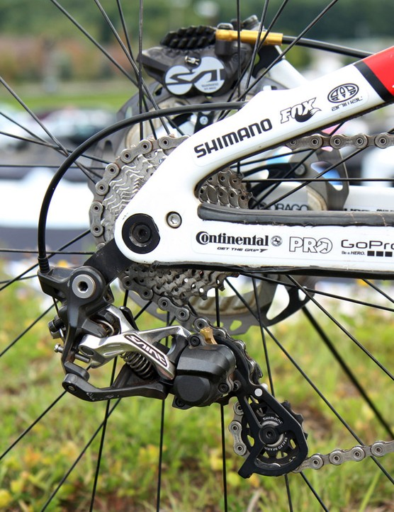 The Shimano Saint rear derailleur is mounted to a dedicated direct-mount hanger