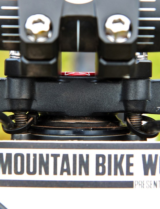 The forward bolts used to mount the stem to the fork crown are extra long with nuts added to the ends to provide a handy place to secure the number plate