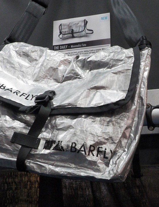 Bar Fly is continuing to expand outside of computer mounts with soft goods such as this ultralight - and extremely compactable - messenger bag. Bar Fly says it'll fold into the size of a wallet and yet can hold a 13in laptop computer or a six-pack of beer