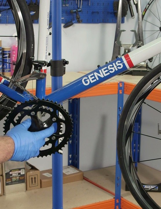 Insert the driveside crank through the bottom bracket, passing it through the chain first