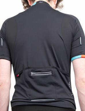 The back of the jersey has small reflective logos, and a nifty water resistant zippered pocket is a welcome addition
