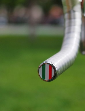 The paper-thin Benotto Cello plastic handlebar tape is finished off with a little tricolore plug
