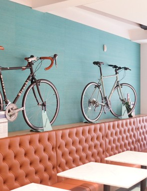 Bikes line the walls as well as the tables