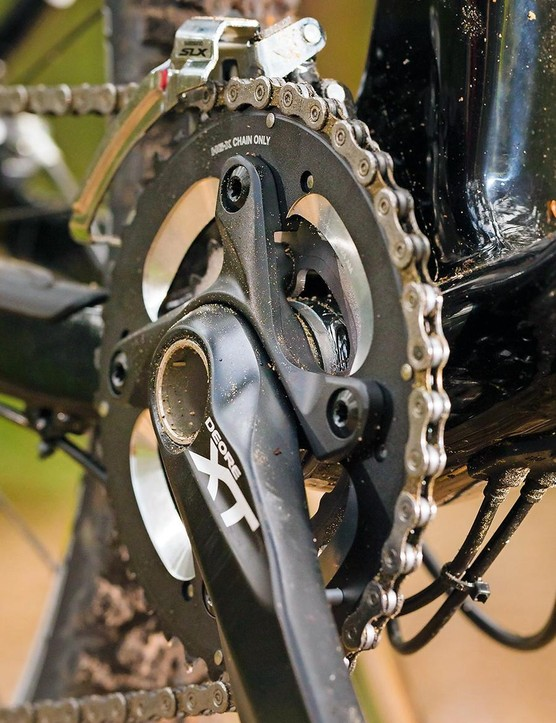 The Shimano XT and rear derailleur work well with the SLX shifters