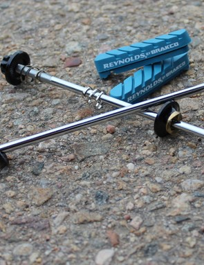 The included titanium skewers are quite light (35g for the pair), and the Cryo-Blue Power brake pads improve the stopping over prior generations, but still cause some squeal under heavy load