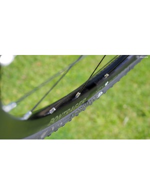 Asymmetrical rim profiles help keep spoke tensions more even from side to side