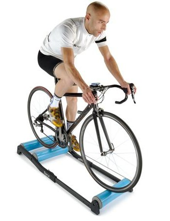Man riding rollers during indoor training