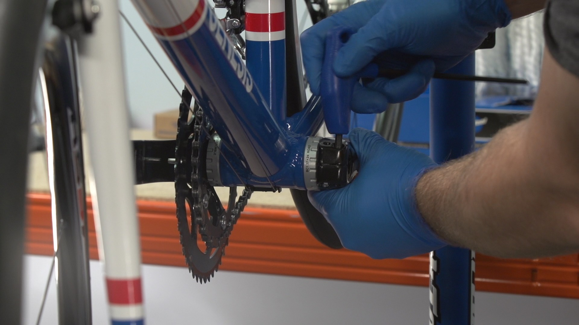 You'll need to remove the crankset in order to get at the chainrings