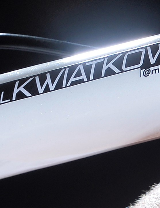 A new name badge incorporates the rainbow colours and Kwiatkowski's twitter handle